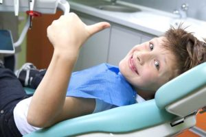boy-giving-thumbs-up-in-dentist-chair