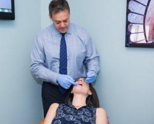 Dr Gordon with adult orthodontic patient