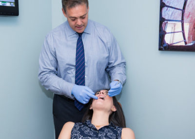 Dr Gordon with an adult orthodontic patient