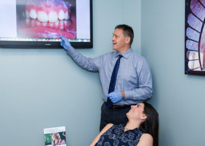 Dr Gordon explains the patient's teeth