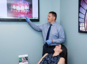 Dr Gordon explaining teeth to adult orthodontic patient