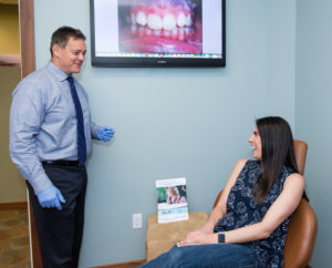 Dr Gordon is greeting an adult orthodontic patient