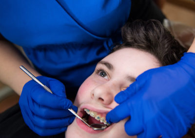 Teeth checkup of teenager