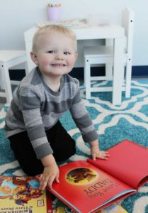 toddler with book